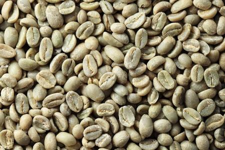 에티오피아 유기 Yirga Cheffe 녹색 커피 콩 배경 스톡 콘텐츠