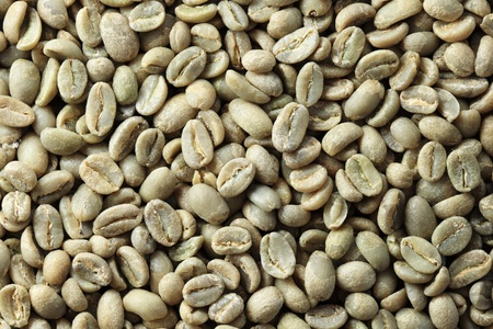 Ethiopian organic Yirga Cheffe green coffee bean background