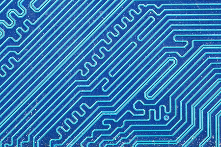 blue electric printed circuit board background macro image Stock Photo