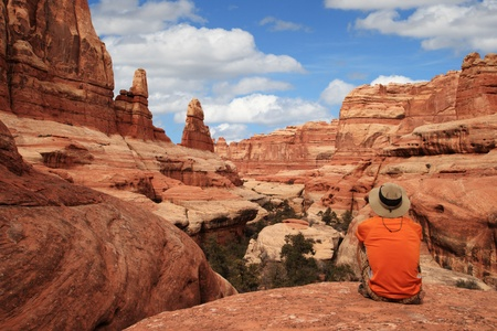a sitting man admires the view in Canyonlands National Park Stock Photo - 9339067