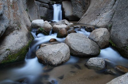 silky smooth waterfall in the carved granite canyon of McGee Creek Stock Photo - 9670202