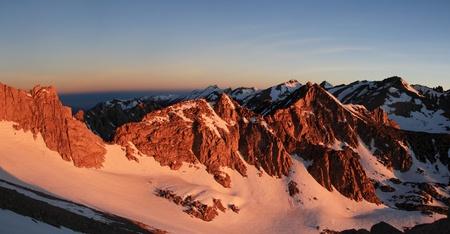 john muir wilderness: sunrise orange light on snowy Sierra Nevada Mountains near Kearsarge Pass