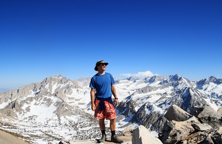 kings canyon national park: a man on the mountain top of Mount Rixford in Kings Canyon National Park in the Sierra Nevada mountains and blue sky copy space