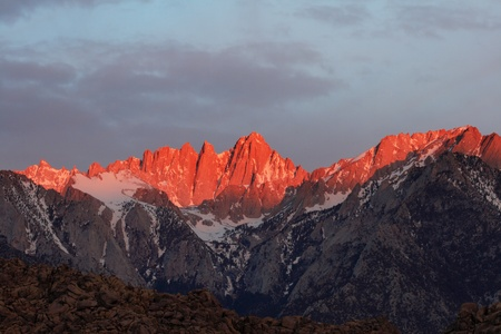 Mount Whitney the highest point in the lower 48 states lit by early morning alpenglow Stock Photo - 9940130