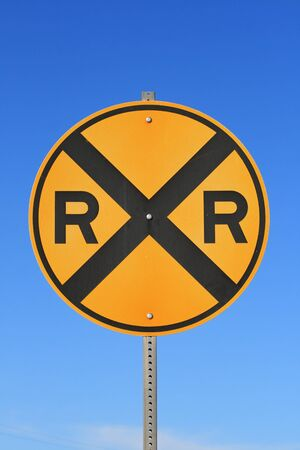 round railroad crossing road sign with blue sky background Stock Photo - 9940128