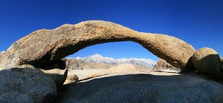 high sierra: high sierra mountain peaks viewed through an alabama hills granite arch