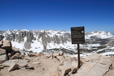 john muir wilderness: the 11760 foot Kearsarge Pass over the Sierra Nevada into Kings Canyon National Park in California with sign