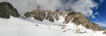 panorama of Basin Mountain in the Sierra Nevada with clouds obscuring the summit Stock Photo - 10256096