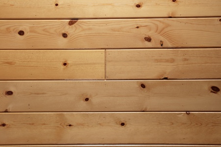 varnished knotty wood plank paneling background texture Stock Photo