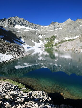 reflection of Ed Lane peak and the Thumb mountain in Birch Lake in the Sierra Nevada mountains Stock Photo - 10418863