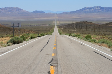 lonely highway 6 in Nevada stretches across a wide valley in a straight line with heat ripples in the distance Stock Photo - 10496251
