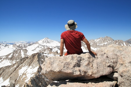 back view of a man sitting on Feather Mountain top enjoying the view Stock Photo - 10526260