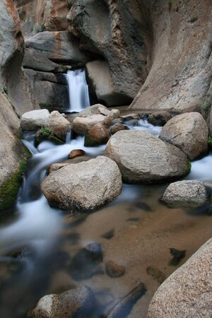 vertical image of silky smooth waterfall in the carved granite canyon of McGee Creek Stock Photo - 10627401
