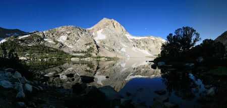 sierras: Piute Lake with reflection of peak in the early morning Stock Photo