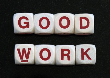 letter blocks: good work spelled out in letter blocks