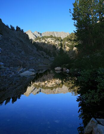 mountain reflection in a small pool in the Sierra Nevada mountains Stock Photo - 10669852