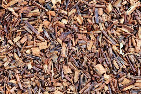 red bush tea: macro image of rooibos red tea leaves and bark