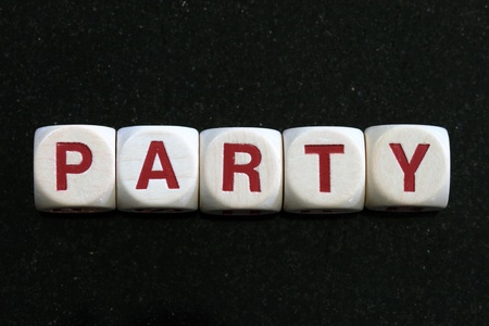 party spelled out in letter blocks with dark background Stock Photo - 10669855