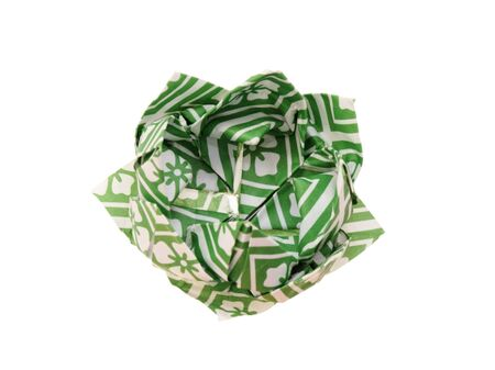 origami lotus flower made from green and white patterned paper isolated on white photo
