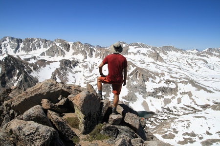 back view of a man standing on mount Emerson enjoying the view Stock Photo - 10894382