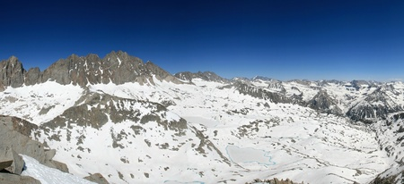 sierra snow: Panorama of the Sierra Nevada Mountains Palisade Basin from the summit of Columbine Peak with a lot of snow Stock Photo