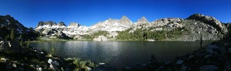 mountain lake panorama of Ediza Lake and the Minaret mountains in the Sierra Nevada of California photo