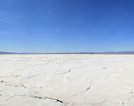 Bristol dry lake salt pan in the Mojave Desert of California with blue sky photo