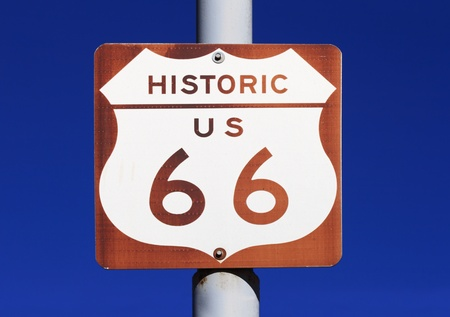 brown and white historic US route 66 sign with blue sky background Stock Photo - 11731450