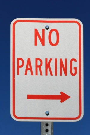 red and white no parking sign with an arrow and blue sky background Stock Photo - 11863043