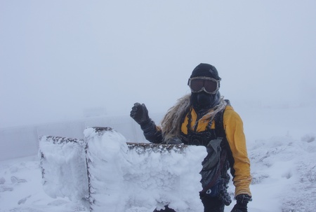 A man on the summit of Mount Washington in near whitout conditions with face mask and goggles and rime ice Stock Photo - 11863045