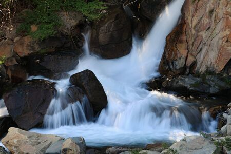 rocky waterfall in a creek in the Sierra Nevada with smooth silky water Stock Photo - 11863070