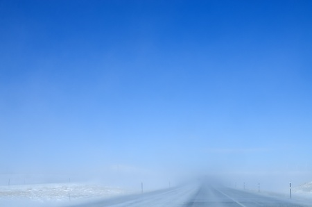 wyoming: blowing snow on an interstate highway reduces visibility on a clear day