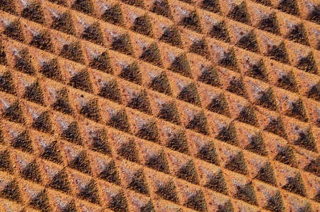 background of rusty iron metal with diamond texture pattern