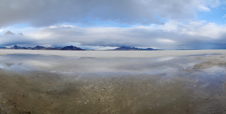 Panorama of the Bonneville Salt Flats in Utah with cloudy skies and a puddle in the foreground Stock Photo - 12097199