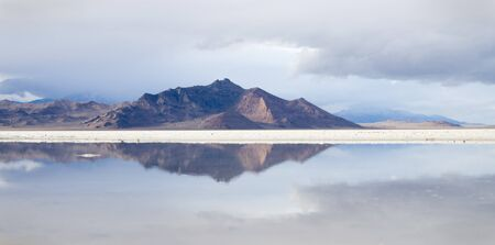reflection of distant mountains in a pool in the Bonneville Salt Flats Stock Photo - 12380006
