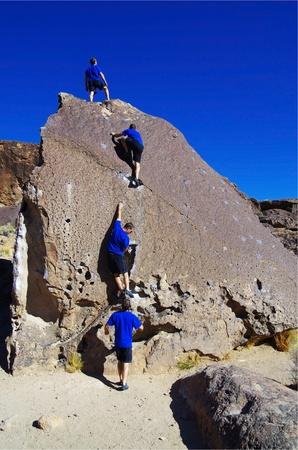 a composite series of a man rock climbing up a boulder Stock Photo - 12380002