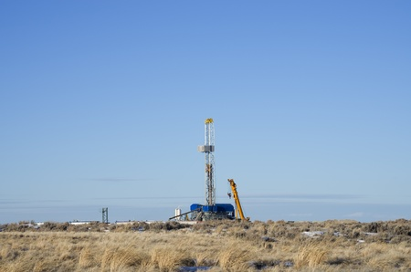 distant drill rig set up for winter drilling in Wyoming Stock Photo - 12405018