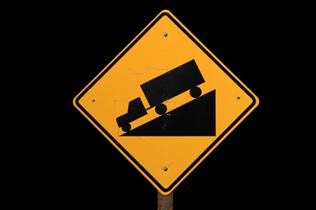 downgrade: steep road sign with a truck driving down a steep downgrade in black and yellow on black background