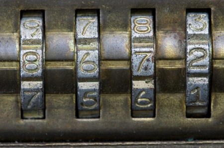 tight focus: macro image of brass combination lock with the number set to 8672