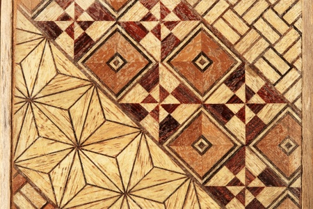 macro image of inlaid abstract geometric wood pattern