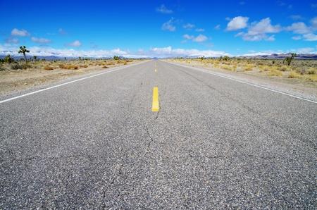 empty high desert road heading straight across Nevada Stock Photo - 13030845