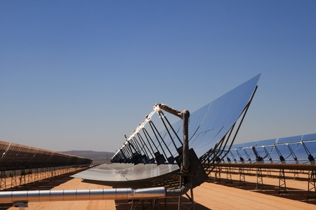 SEGS solar thermal energy desert electricity plant with parabolic mirrors concentrating the sunlight with blue sky copy space Stock Photo - 13021992