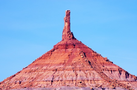 six shooter: North Six Shooter desert sandstone tower with a blue sky background