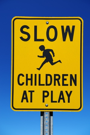 Slow Children at Play street sign with blue sky background Stock Photo - 13057221