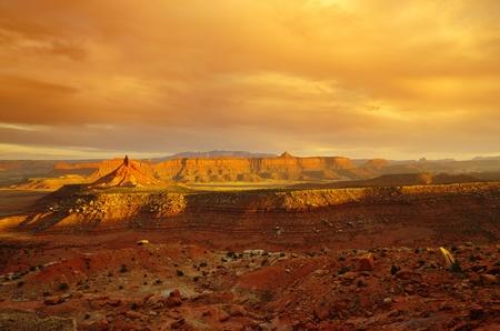 six shooter: desert landscape near canyonlands utah with dramatic evening lighting