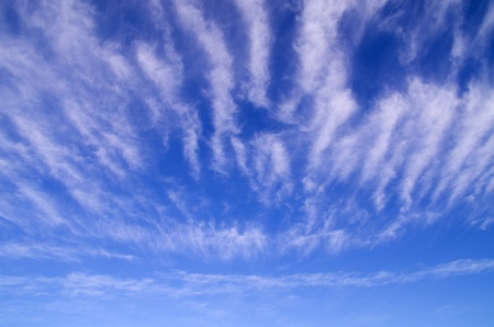 blue sky with striped white streaky clouds Stock Photo