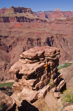 plateau point: a man climbing up to an overlook at Plateau Point in the Grand Canyon Stock Photo