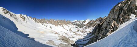 panorama of Kearsarge Lakes Basin in the Sierra Nevada covered in snow photo