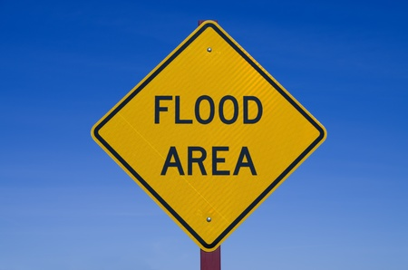 flood area: flood area road sign with blue sky background