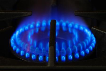 grate: gas stove range burner with dark metal grate